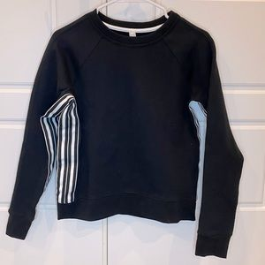 Black sweatshirt with white stripes. Athleta.